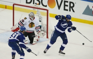 Jun 3, 2015; Tampa, FL, USA; Tampa Bay Lightning center Alex Killorn (17) redirects the puck past Chicago Blackhawks goalie Corey Crawford (50) for a goal in the first period in game one of the 2015 Stanley Cup Final at Amalie Arena. Mandatory Credit: Reinhold Matay-USA TODAY Sports
